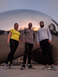 Running with co-workers and stopping in front of the Bean